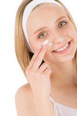 Facial care teenager woman apply cream