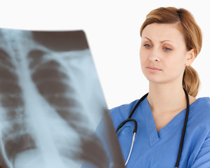 Concentrated female doctor looking at an X-ray