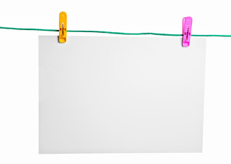 Blank piece of paper and colored clothespins