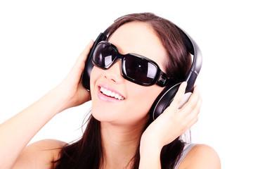 Attractive brunette woman listening  music