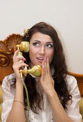Beautiful girl talking on telephone