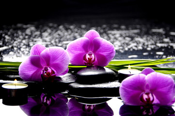 Photo sur Aluminium Spa Spa still life with set of pink orchid and stones reflection