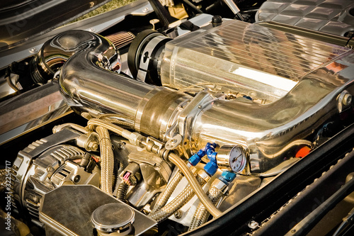 Wall mural powerful vehicle engine with golden tones on the chrome