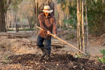 farmer making compost