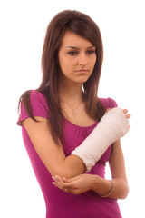 young girl with broken hand in pain