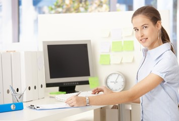 Young office worker woman at desk