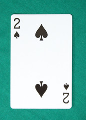 two of spades on card table