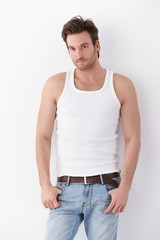 Young man in undershirt and jeans