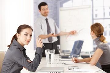 Attractive female listening to presentation