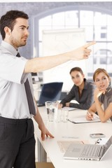 Young man presenting in meeting room