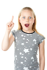 Surprised little girl pointing with finger