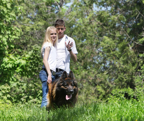young couple with dog outdoors