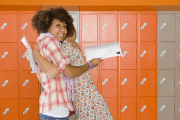 Excited students hugging after receiving good news about test results