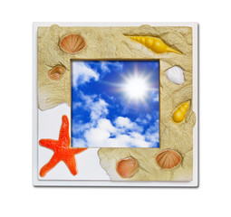 Frame of sea shell on blue sky