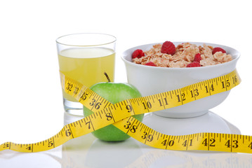 Diet weight loss concept with tape measure green and organic gre