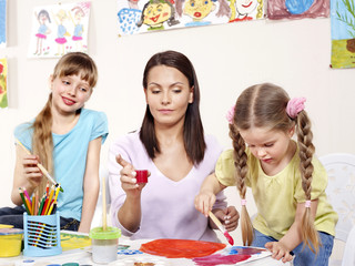 Children painting in preschool.