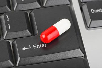 Pills on computer keyboard