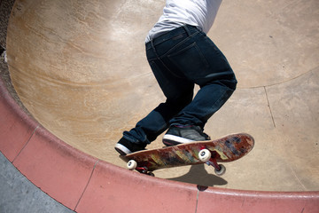 Skateboarder Skating Inside the Bowl