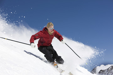 Female Skiing against Blue Sky