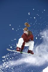 Female Snowboarder in Flight