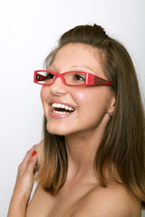 beautiful young girl with glasses looking something