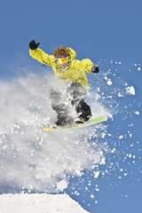 Snowboarder Airborne against Clear Blue Sky