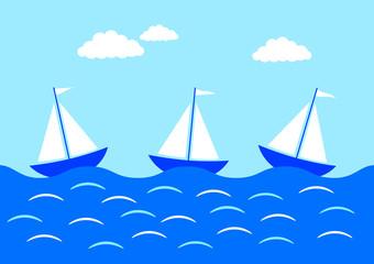 Three sailboats on blue sea