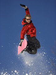 Extreme Snowboard Jump against Blue Sky