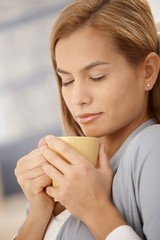 Beautiful woman having hot tea