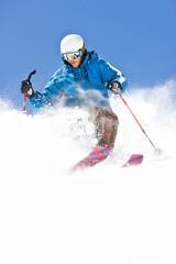 Powder Skiing against Colorado Blue Sky
