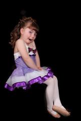 sweet little ballerina posing isolated on black