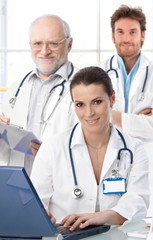 Doctors working at desk