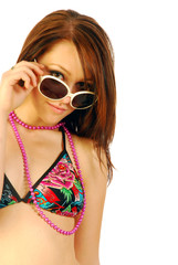 Wonderful girl plays with sunglasses