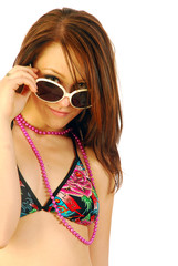 Beautiful Girl with necklace plays with sunglasses