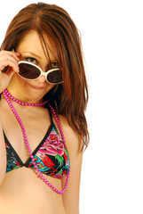 Beautiful girl plays with sunglasses