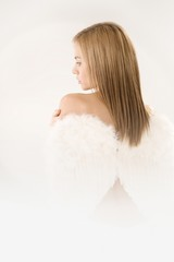 Attractive girl with angel wings back view