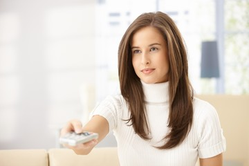 Attractive woman with remote control