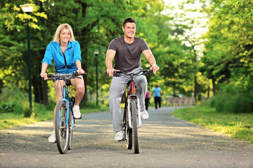 Wall Murals Cycling Happy couple biking in the park