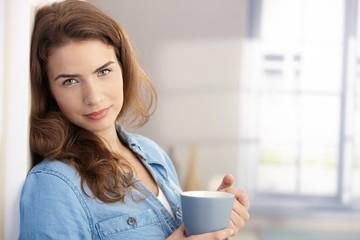 Portrait of beautiful woman with tea mug