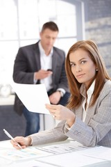 Attractive female working at desk in office