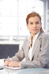 Portrait of attractive businesswoman in office