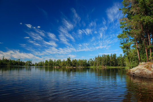A wilderness lake and summer skies