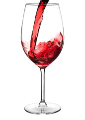 Pouring red wine into wine glass (isolated on white)