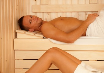 Portrait of handsome man in sauna