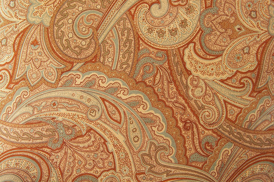 A brown paisley 70s style design pattern