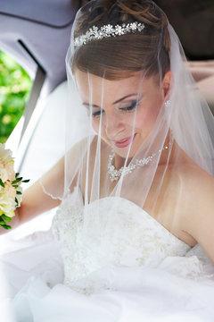 Beauty bride in wedding limo