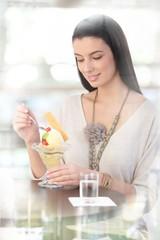 Pretty woman enjoying ice cream