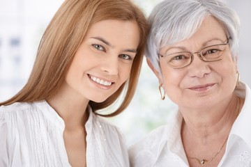 Closeup portrait of young woman and mother smiling