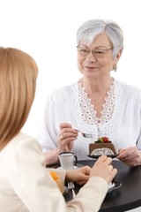 Senior woman with cake smiling