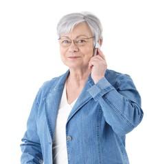 Modern senior lady on mobile phone